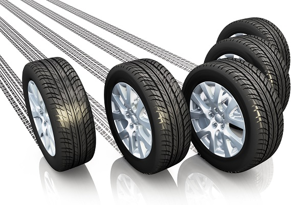 Creative automotive concept: set of car wheels with tyre prints isolated on white background with reflection effect